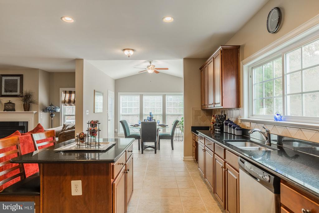 Open Kitchen flows into large sun/morning room - 4157 AGENCY LOOP, TRIANGLE