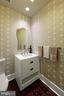 Half bath is off the hallway..neutral wall decor. - 601 N FAIRFAX ST #316, ALEXANDRIA