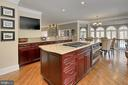 Kitchen opens to family room and game room - 8345 CATHEDRAL FOREST DR, FAIRFAX STATION