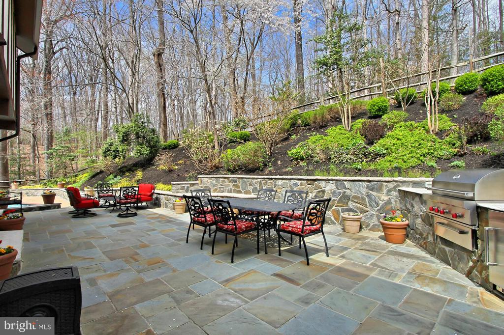 Stone patio near pool - 8345 CATHEDRAL FOREST DR, FAIRFAX STATION