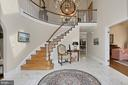 Stunning two story foyer with curved staircase - 8345 CATHEDRAL FOREST DR, FAIRFAX STATION