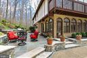 Look at the incredible landscaping & stonework. - 8345 CATHEDRAL FOREST DR, FAIRFAX STATION