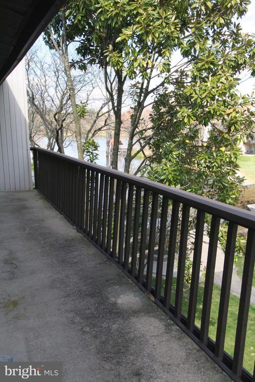 Long balcony overlooks serene setting - 10101 WINDSTREAM DR #6, COLUMBIA
