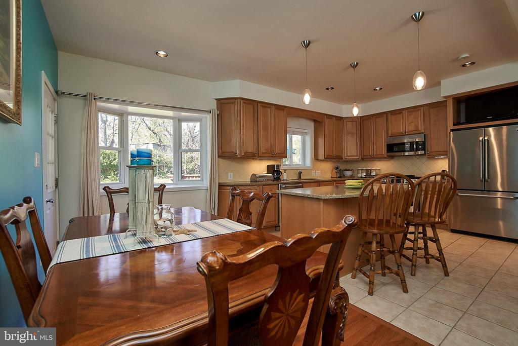 Dining area with hardwood floor and access to deck - 6100 LEEWOOD DR, ALEXANDRIA