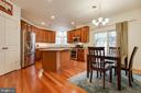 Gourmet Kitchen w/Granite Counters/Island/Pantry - 707 INVERMERE DR NE, LEESBURG