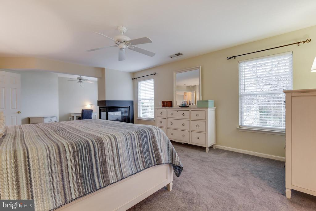 Master Bedroom with 3 Sided Gas Fireplace - 707 INVERMERE DR NE, LEESBURG