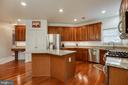 Gourmet Kitchen with Hardwood Floors - 707 INVERMERE DR NE, LEESBURG