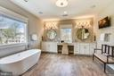 separate tub and heated floors - 301 NIBLICK DR SE, VIENNA