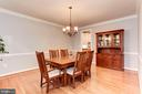 Formal dining with chair railing and crown molding - 8643 WOODWARD AVE, ALEXANDRIA