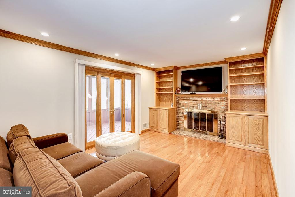 Family Room w/ wood burning fireplace & built-ins - 8515 ORDINARY WAY, ANNANDALE