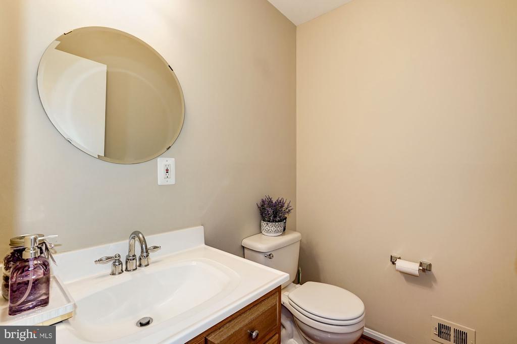 1/2 Bathroom on main level w/ hardwood floors - 8515 ORDINARY WAY, ANNANDALE