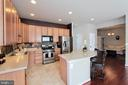 Gourmet kitchen with ample cabinetry and pantry - 20413 BOWFONDS ST, ASHBURN