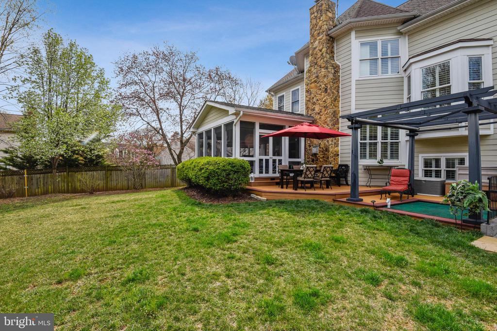 REAR VIEW OF HOME WITH DECK AND PATIO - 2017 WOODFORD RD, VIENNA