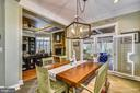 DINING IN THE KITCHEN WITH A VIEW OF THE SUNROOM - 2017 WOODFORD RD, VIENNA