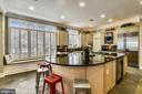 7' X 11' ISLAND WITH GRANITE COUNTERTOP - 2017 WOODFORD RD, VIENNA