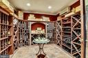 BUILT-IN RACKS FOR MANY WINE CHOICES. - 2017 WOODFORD RD, VIENNA