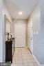 Foyer with hall closet - 20281 BEECHWOOD TER #302, ASHBURN