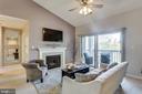 Living Room w/fireplace/vaulted ceiling/deck - 20281 BEECHWOOD TER #302, ASHBURN
