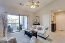 Living Room with nice balcony space - 20281 BEECHWOOD TER #302, ASHBURN