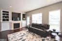 Family room with gas fireplace - 20413 BOWFONDS ST, ASHBURN
