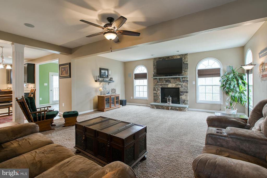 Family room  with stone fireplace - 145 DONOVAN LN, STAFFORD