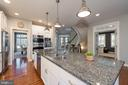 View from kitchen to staircase and office - 23013 OLYMPIA DR, ASHBURN