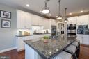 Extended island/double wall ovens/generous cooktop - 23013 OLYMPIA DR, ASHBURN