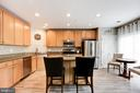 Kitchen with SS appliances and cupboards galore - 43545 MAHALA ST, LEESBURG