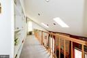 Upper Level Hallway overlook to Family Room - 5608 CAVALIER WOODS LN, CLIFTON