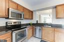Kitchen Opens to Dining Room - 14111 BETSY ROSS LN, CENTREVILLE