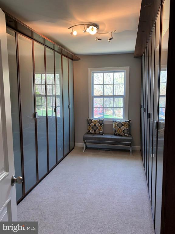 Master closet w/diff storage design in each area - 7608 MANOR HOUSE DR, FAIRFAX STATION