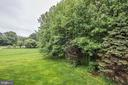 Home backs to trees for privacy. - 1211 RESTON AVE, HERNDON