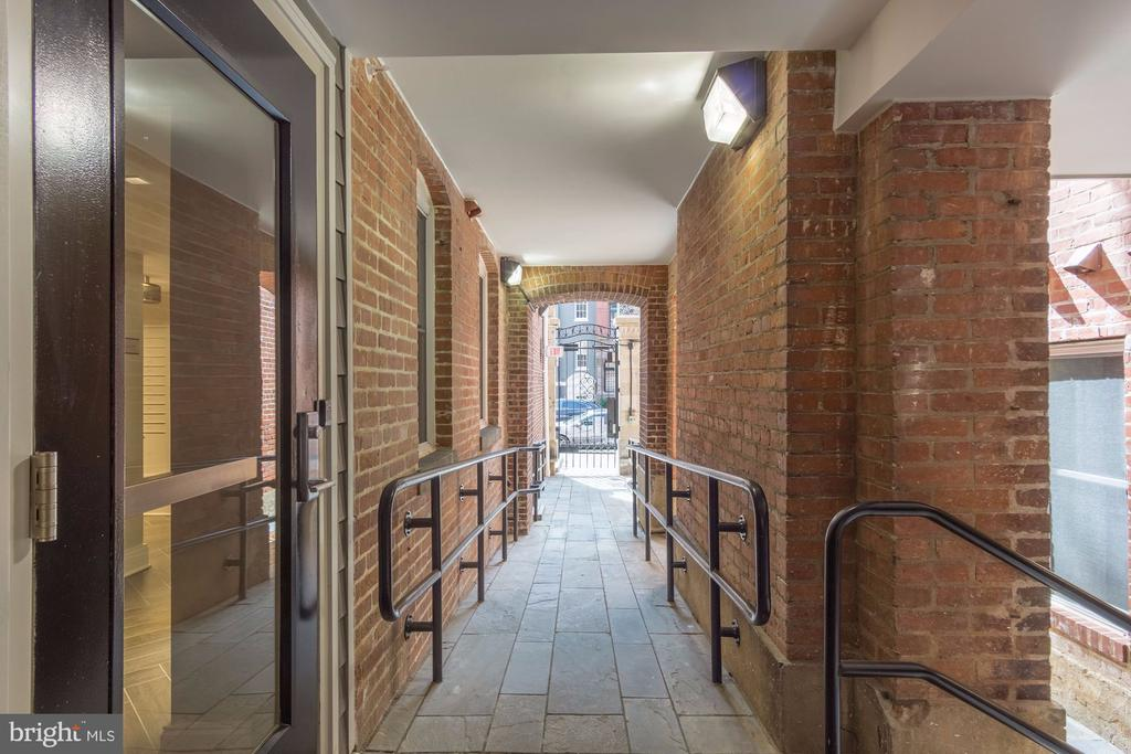 Historic walkway from secure iron gate - 1745 N ST NW #208, WASHINGTON