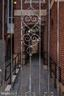 Secure iron gate to a walkway - 1745 N ST NW #208, WASHINGTON