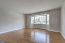 Dining room with wood floors and natural light. - 7007 PARTRIDGE PL, HYATTSVILLE