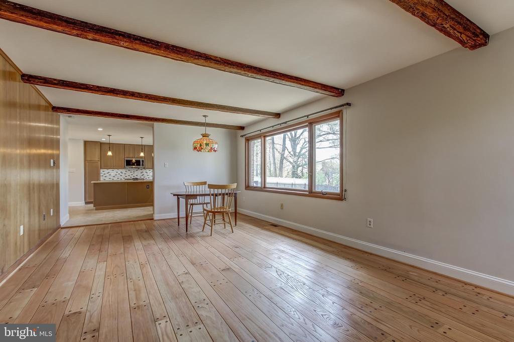 Wood floors, beams giving family room extra charm. - 7007 PARTRIDGE PL, HYATTSVILLE