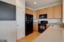 Kitchen with wood floors - 7127 AZALEA DR, RUTHER GLEN