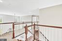 Two staircases from foyer and great room/kitchen - 10407 DEL RAY CT, UPPER MARLBORO