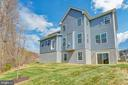 Rear of home on just under 1/2 acre. - 10407 DEL RAY CT, UPPER MARLBORO