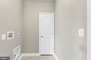 Laundry/mud room between garage and kitchen - 10407 DEL RAY CT, UPPER MARLBORO