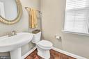 Powder room on main level with optional hardwood - 10407 DEL RAY CT, UPPER MARLBORO