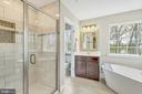 Master bath with separate shower and tub - 10407 DEL RAY CT, UPPER MARLBORO