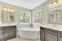 Master bath with tub and two vanities - 10407 DEL RAY CT, UPPER MARLBORO
