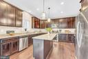 Kitchen with upgraded range and lighting package - 10407 DEL RAY CT, UPPER MARLBORO