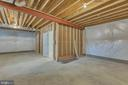 Unfinished area in basement. - 10407 DEL RAY CT, UPPER MARLBORO
