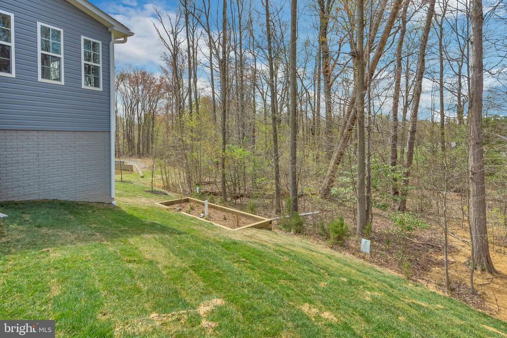 Sodded yards are a part of every home. - 10407 DEL RAY CT, UPPER MARLBORO