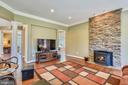Family Room with Stone Accent Wall & Pellet Stove - 15579 WOODGROVE RD, PURCELLVILLE