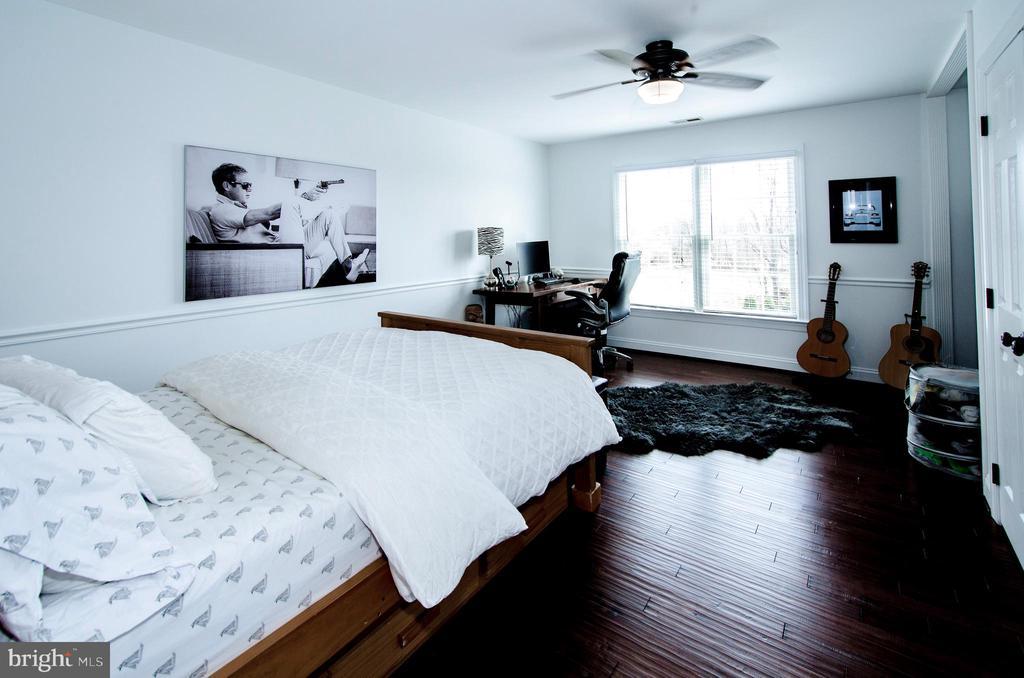 Bedroom 2 with wood floors and custom closet- - 14974 MERRITT FARM LN, LEESBURG
