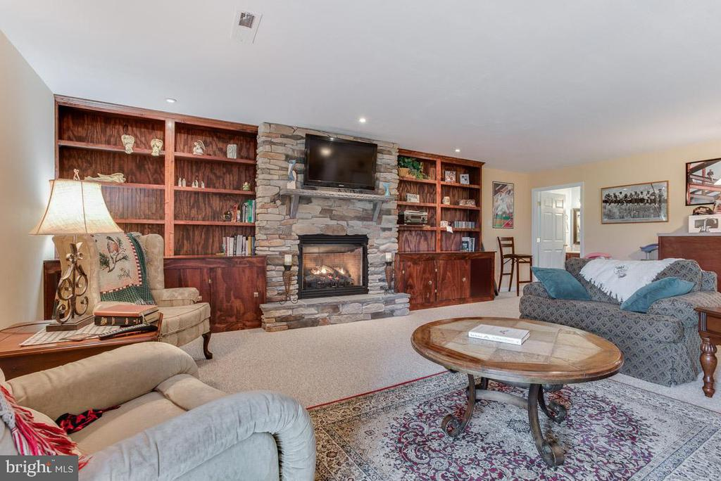 Built In Bookcases flank gas Fireplace - 10179 LAWRENCE LN, LOCUST GROVE