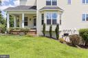 Large side yard with in ground sprinkler system - 18911 MIATA LN, TRIANGLE